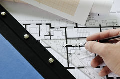 Architect drawing on desk Royalty Free Stock Photo