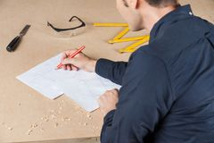 Architect Drawing Diagram At Table In Workshop Stock Photography