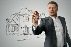 Architect drawing house development sketch Stock Images