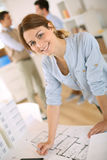 Architect drawing plan in office Stock Photo