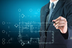 Architect drawing on print construction project Stock Images