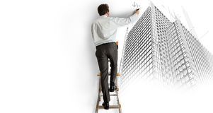 Architect drawing a project. Architect draws a project on a staircase Stock Image
