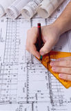 Architect drawing rolls and plans blueprints Stock Photography