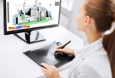 Architect with drawing tablet in office Stock Image