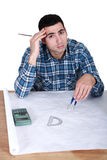 Architect with drawings. Architect with some technical drawings royalty free stock image