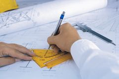 Architect draws a blueprint Royalty Free Stock Photo