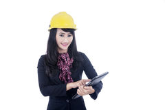 Architect with e-tablet isolated over white. Beautiful architect holding a tablet isolated over white Stock Photos