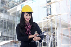 Architect with e-tablet working outdoor. Beautiful architect with e-tablet working outdoor Stock Photos