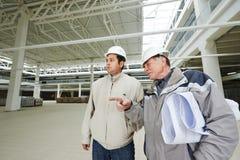 Architect en van de bouwingenieur arbeider stock fotografie
