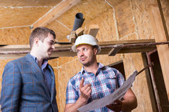 Architect en Voorman Consulting Building Plans royalty-vrije stock foto's