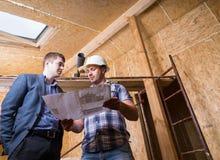 Architect en Voorman Consulting Building Plans Royalty-vrije Stock Fotografie