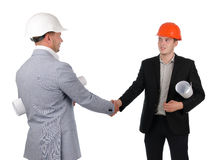 Architect and engineer or builder shaking hands Stock Photos