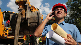 Architect or Engineer With Cell Phone on the Construction Site royalty free stock photos