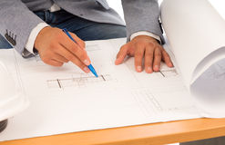 Architect or engineer checking a blueprint Royalty Free Stock Photography