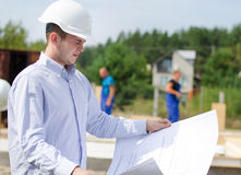 Architect or engineer checking plans on site Royalty Free Stock Photos
