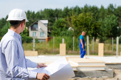 Architect or engineer checking plans on site Stock Photo
