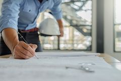 Architect Engineer Design Working on Blueprint Planning Concept. Construction Concept royalty free stock photo