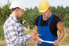 Architect or engineer explaining something Stock Photo