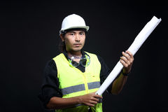 Architect Engineer in hard hat and safety equipment Royalty Free Stock Image