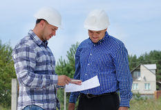 Architect and engineer having a discussion Stock Photo