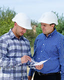 Architect and engineer having a discussion Stock Photos