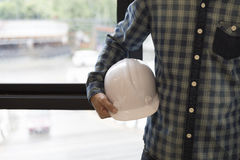 Architect engineer holding helmet  - construction concept Royalty Free Stock Images