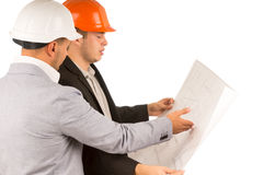 Architect and engineer looking at a blueprint Stock Photography
