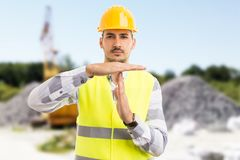 Architect or engineer making time out pause break gesture. On construction site or pit outdoors Stock Photography