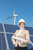 Architect or engineer posing at solar panels. In wind farm Royalty Free Stock Image