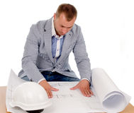 Architect or engineer studying building plans Royalty Free Stock Photos