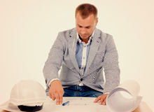 Architect or engineer studying building plans Stock Photos