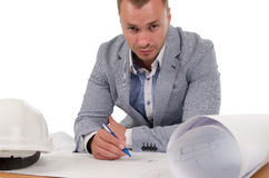 Architect or engineer studying building plans Royalty Free Stock Photo