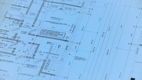 Architect or engineer working on blueprint on architects workplace - architectural project stock footage