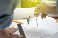 Architect or engineer working on blueprint Royalty Free Stock Photography