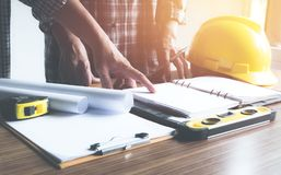 Architect engineer working concept and construction tools or safety equipment on table. royalty free stock photos
