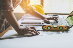 Architect engineer working concept and construction tools or safety equipment on table. royalty free stock photo