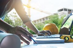 Architect engineer working concept and construction tools or safety equipment on table. stock image