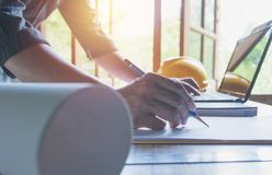 Architect engineer working concept and construction tools or safety equipment on table. stock photo