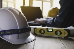 Architect engineer working concept with laptop and construction tools or safety equipment on table stock photos