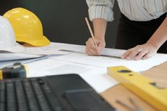 Architect engineer working on house blueprint of real estate pro. Ject at workplace. construction & building concept stock images
