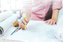 Architect or engineer working in office, Construction concept. Royalty Free Stock Photography