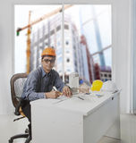 Architect engineer working in office room against building const. Ruction through mirror window  use for architecture and engineering construction industry Stock Photo