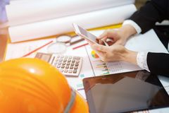 Architect or engineer working project accounting with graph with tools in office. Construction account concept stock photo