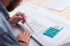 Architect estimating project cost Royalty Free Stock Photography