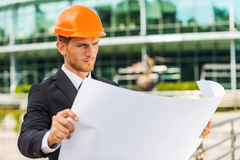 Architect examining blueprint. Royalty Free Stock Photography