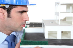 Architect examining model Stock Photo