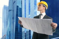Architect executive businessman with plan. And hard hat Royalty Free Stock Image
