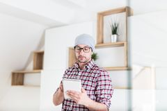 Architect or executive using tablet device at his office. Project planning concept stock image