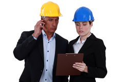 Architect and female assistant Royalty Free Stock Photos
