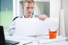 Architect finishing his work Stock Photography
